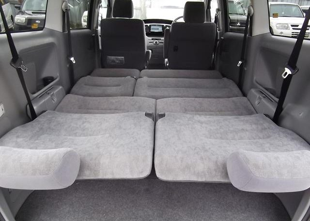 2006 Toyota Voxy 2.0 X Ltd Edn 4WD Auto 8 Seater MPV, Grey (V33), Interior View Rear Seats Down Made Into A Bed. Japanese import cars for sale UK.