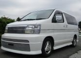 1998 Nissan Elgrand 3.2 TD Optional 4WD Auto Rider 8 Seater MPV (E30), Front View, Passengers Side. Japanese imports for sale.