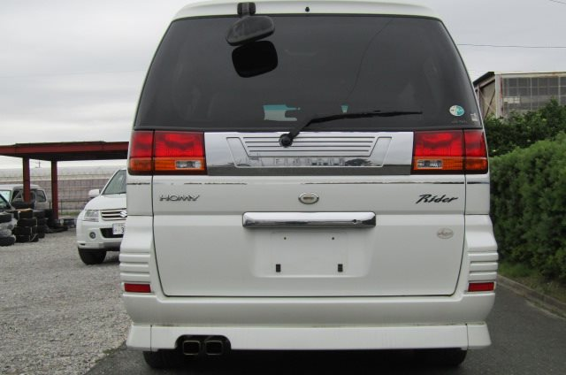 1999 Nissan Elgrand 3.3 V6 Auto Optional 4WD E50 Rider Autec 8 Seater MPV (E8), Rear View. Japanese import cars.