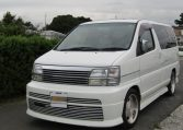 1999 Nissan Elgrand 3.3 V6 Auto Optional 4WD E50 Rider Autec 8 Seater MPV (E8), Front View, Passengers Side. Japanese imports for sale.