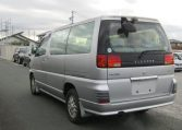 1998 Nissan Elgrand 3.3 E50 Optional 4WD Auto 8 Seater MPV (E87), Rear View, Passengers Side. Japanese car imports UK.