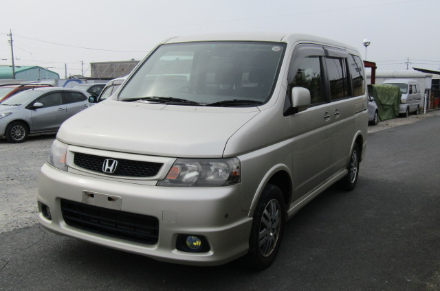 2004 Honda Stepwagon 2.0 4wd Spada Auto 8 Seater MPV (H5), Front View, Passengers Side. Japanese imports for sale.