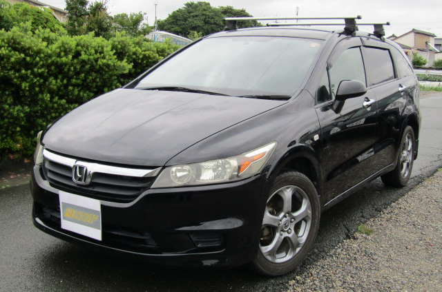 2007 Honda Stream 1.8 4wd X Style Auto 7 Seater MPV (H70), Front View, Passengers Side, Japanese import cars.