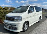 1999 Nissan Elgrand 3.3 V6 E50 Optional 4wd Rider Auto 8 Seater MPV (E12), Front View, Passengers Side.